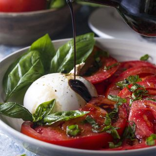 Healthy, simple, and fresh! This summer recipe for tomato burrata salad is drizzled with balsamic and topped with basil for an impressive and easy side.