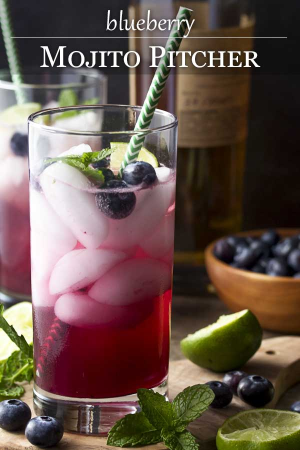 My blueberry mojito pitcher is a fun and easy summer cocktail full of fresh blueberries, mint, lime juice, rum, and simple syrup. Great for a party or a crowd.   justalittlebitofbacon.com #drinkrecipes #cocktails #mojitos #blueberries