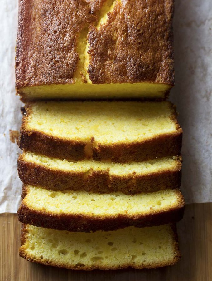 Using both orange zest and orange juice helps make my moist and tender orange pound cake one of the best loaf cake recipes you can bake. Rich in flavor and light in texture! | justalittlebitofbacon.com #italianrecipe #poundcake #cakerecipe #dessertrecipe #oranges #loafcake