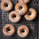 Skip the mess of deep frying and make baked cider donuts instead! These easy fall treats coated in cinnamon sugar are perfect dunked into apple cider for a morning snack or for dessert. | justalittlebitofbacon.com #donuts #doughnuts #applecider #fallrecipes #applerecipes #bakeddonuts