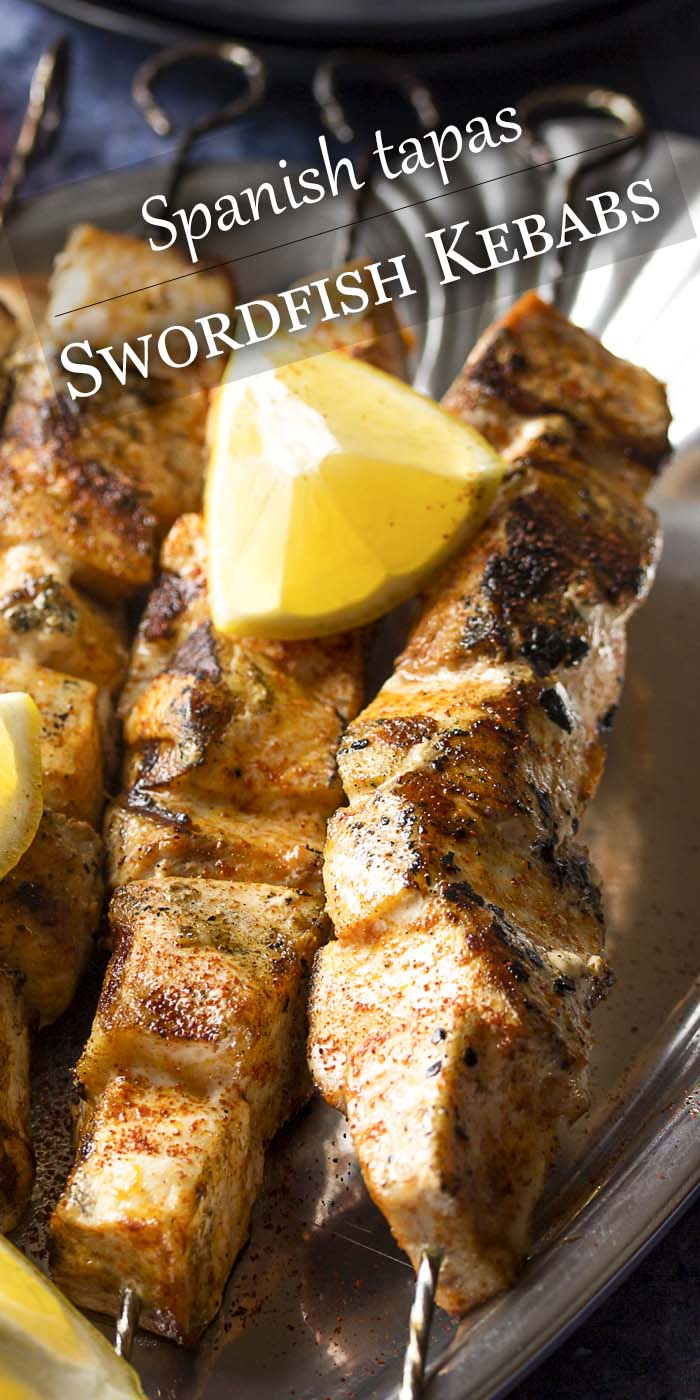 Cubed grilled fish on skewers with text overlay - Swordfish Kebabs.