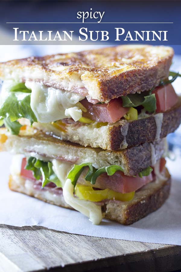 Sandwich on a plate and being picked up with text overlay - Italian Sub Panini.