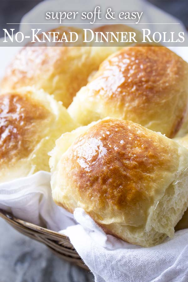 Close up of rolls in a basket with text overlay - No Knead Dinner Rolls.