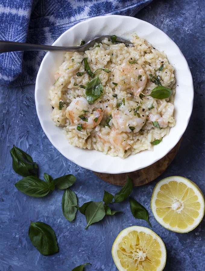 The instant pot makes this pressure cooker shrimp risotto a snap to make! Juicy shrimp, creamy rice, plenty of lemon, and fresh parmesan come together for a simple family meal. | justalittlebitofbacon.com #italianrecipes #instantpot #pressurecooker #risotto #easydinner