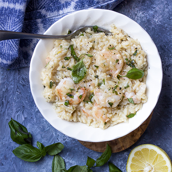 The instant pot makes this pressure cooker shrimp risotto a snap to make! Juicy shrimp, creamy rice, plenty of lemon, and fresh parmesan come together for a simple family meal.   justalittlebitofbacon.com #italianrecipes #instantpot #pressurecooker #risotto #easydinner