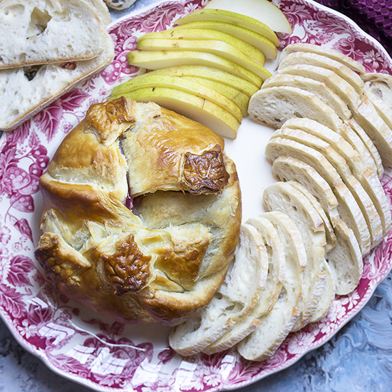 Baked brie in puff pastry topped with jam is a simple and ever popular holiday appetizer, great for Thanksgiving and Christmas. Make one this year and watch it disappear!   justalittlebitofbacon.com #thanksgivingrecipe #christmasrecipe #holidayrecipe #bakedbrie #appetizer #puffpastry #holidays