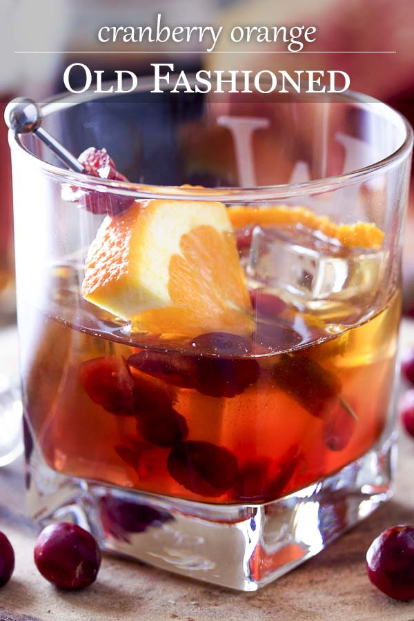 This cinnamon spiced cranberry old fashioned is a festive holiday cocktail made perfect by using bourbon soaked cranberries, orange bitters, and simple syrup. | justalittlebitofbacon.com #thanksgivingrecipe #christmasrecipe #holidayrecipe #cocktail #oldfashioned #cranberrycocktail