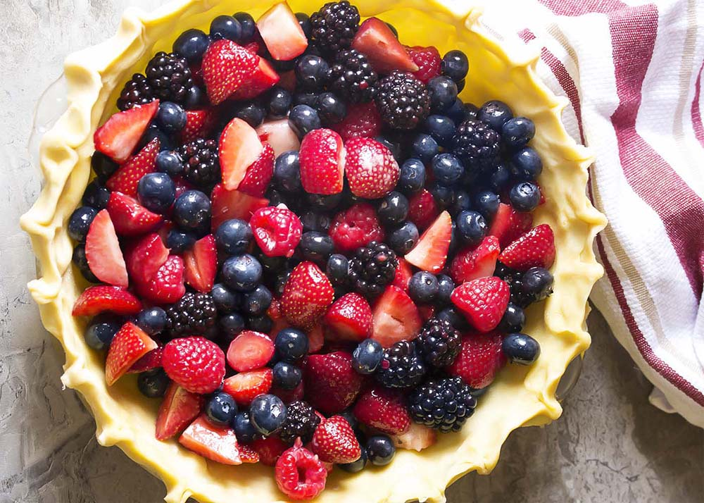 Top view of a mixed berry pie before baking.