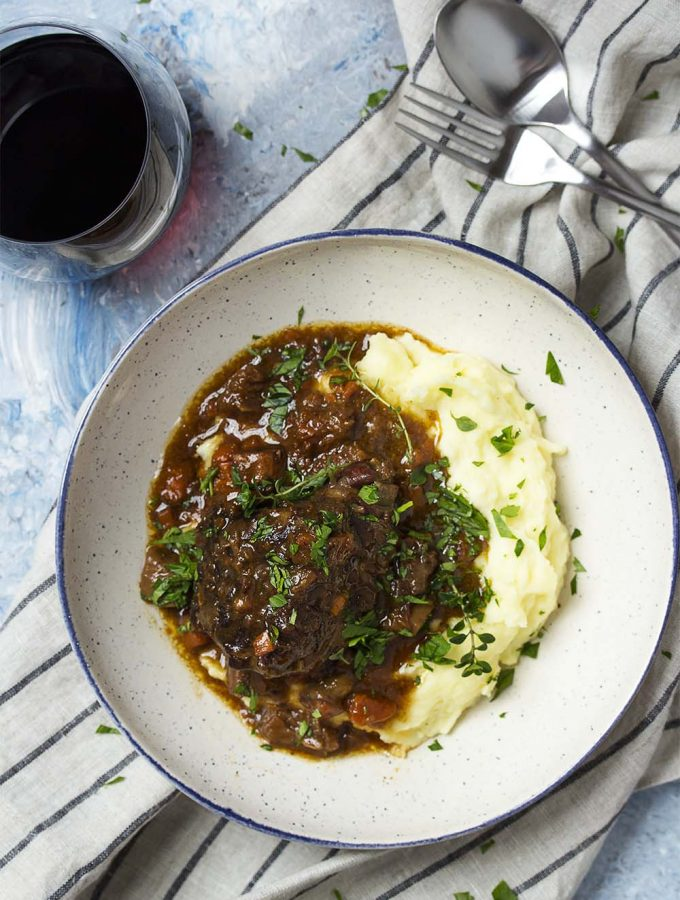 For easy comfort food in the instant pot, make sweet and spicy pressure cooker short ribs braised in red wine with figs and chipotle. Serve over mashed potatoes or with some crusty bread for the sauce. | justalittlebitofbacon.com #comfortfood #shortribs #beefshortribs #pressurecookerrecipe #instantpotrecipe #winterrecipe