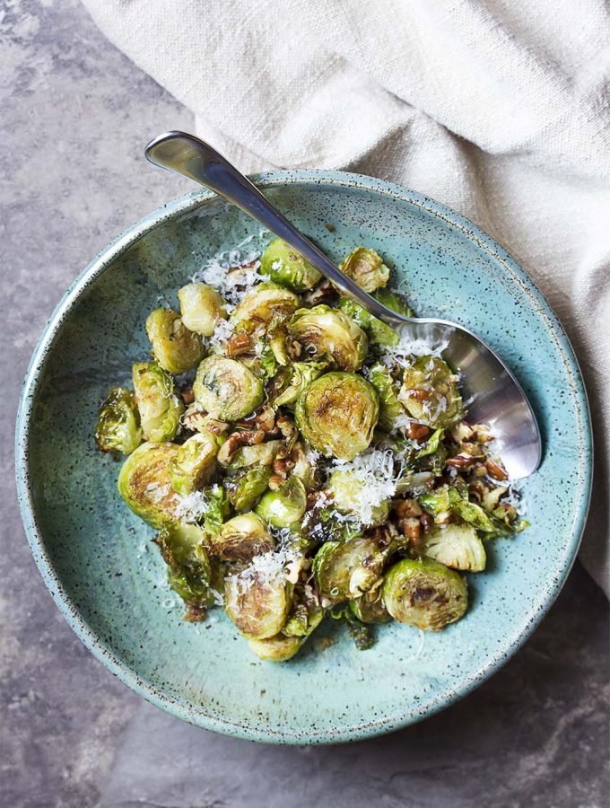 Simple, healthy, and easy! These roasted brussels sprouts with balsamic, parmesan, and pecans are the best ever and make a great side dish. Perfect for weeknights, holidays, and parties. | justalittlebitofbacon.com #sidedish #vegetables #brusselsprouts #holidayrecipe
