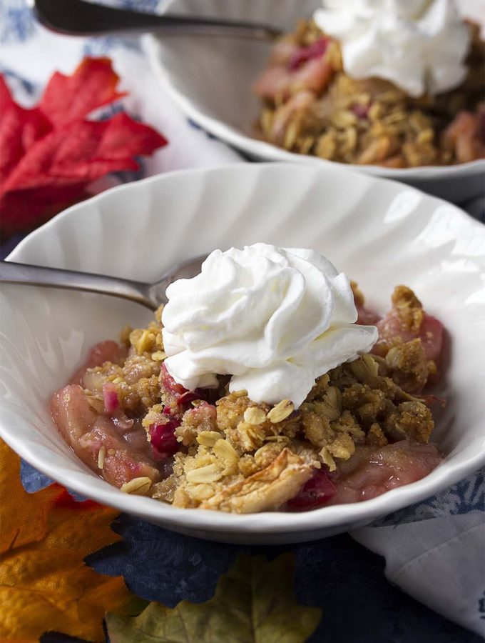 For an easy and healthy dessert, bake my favorite apple cranberry crisp with fresh cranberries and oatmeal topping! Easier than a pie and great for holidays and parties. | justalittlebitofbacon.com #applepie #applecrisp #applecranberry #holidayrecipe #fallbaking #winterbaking #cranberries #apples