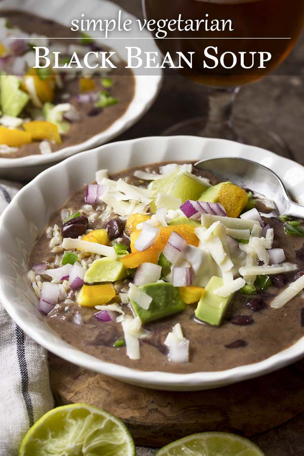 Healthy and easy vegetarian black bean soup is a quick stove top dinner! Creamy without cream and full of flavor, its a perfect weeknight dinner. And even better with ALL the toppings - avocado, jalapenos, sour cream, diced onion, and more. | justalittlebitofbacon.com #blackbeansoup #beansoup #vegetarian #mexicanfood #easydinners