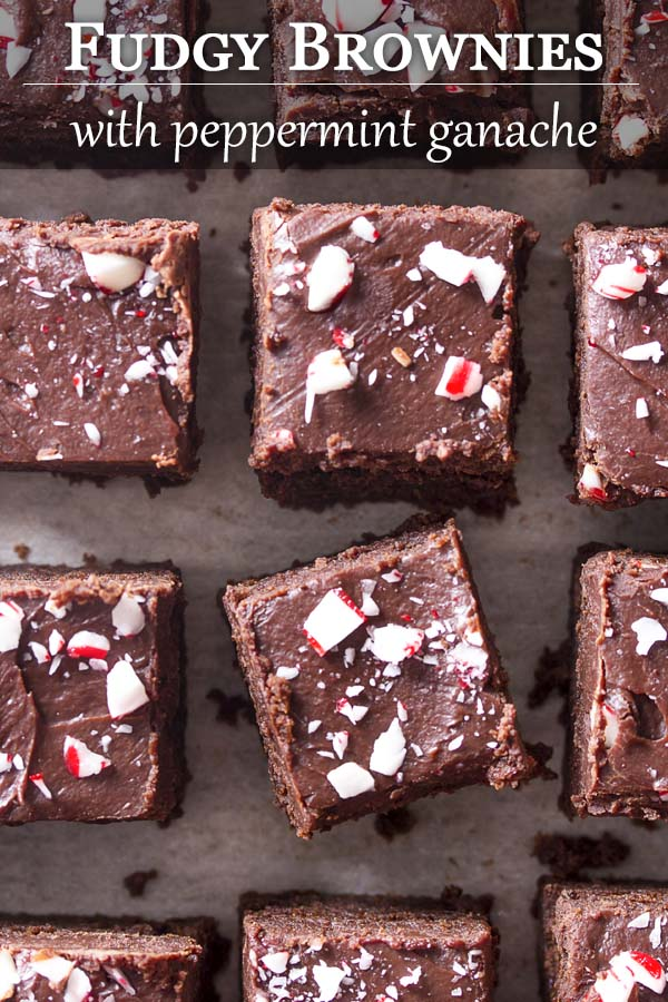 Rows of peppermint topped brownies on a tray with text overlay - Fudgy Brownies.
