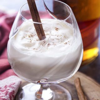 Hot spiced bourbon milk punch is a simple and cozy winter cocktail full of warming spices and sweetened with just a touch of maple syrup. Top with whipped cream to make it extra special! Great as for the holidays or as a Christmas drink. | justalittlebitofbacon.com #cocktails #bourbon #holidayrecipes #hotdrink #winterrecipes