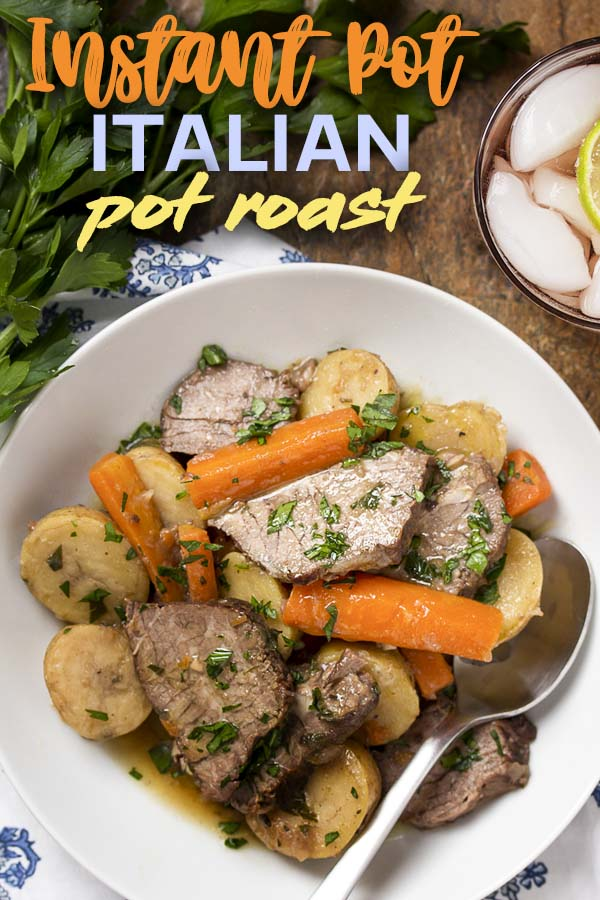 Tender beef, carrots, and potatoes in a bowl with text overlay - Italian Pot Roast.