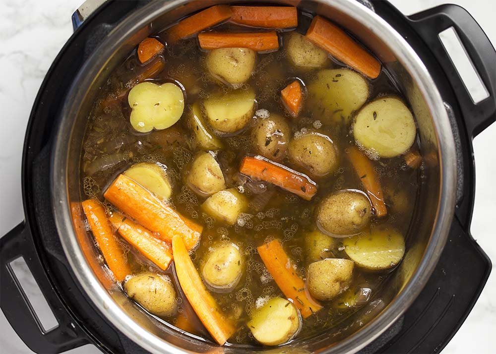 Top view of the Instant Pot full of beef, potatoes, carrots, and wine gravy.