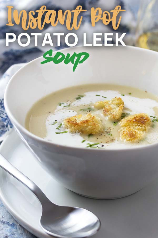Potato soup in a bowl and topped by croutons with text overlay - Potato Leek Soup.