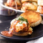 These cheesy Italian meatball sliders are sauteed then simmered in marinara sauce and topped with mozzarella cheese to make great appetizers for parties or a fun dinner recipe! | justalittlebitofbacon.com #italianrecipes #sliders #meatballsliders #gamedayrecipes #partyrecipes #meatballs