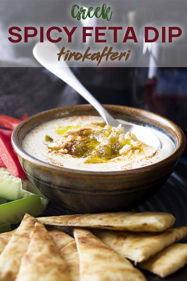 Bowl of dip with pita bread with text overlay - Spicy Feta Dip.