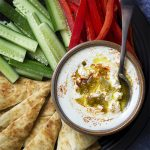 Hot and spicy feta dip is a tasty party appetizer which is also quick and easy to make! This whipped, creamy dip is a perfect addition to a crudites platter or as a spread for grilled meats. Have it as part of a Greek or Mediterranean meal. | justalittlebitofbacon.com #greekrecipes #diprecipes #gamedayfood #partyfood #greek #feta #dip