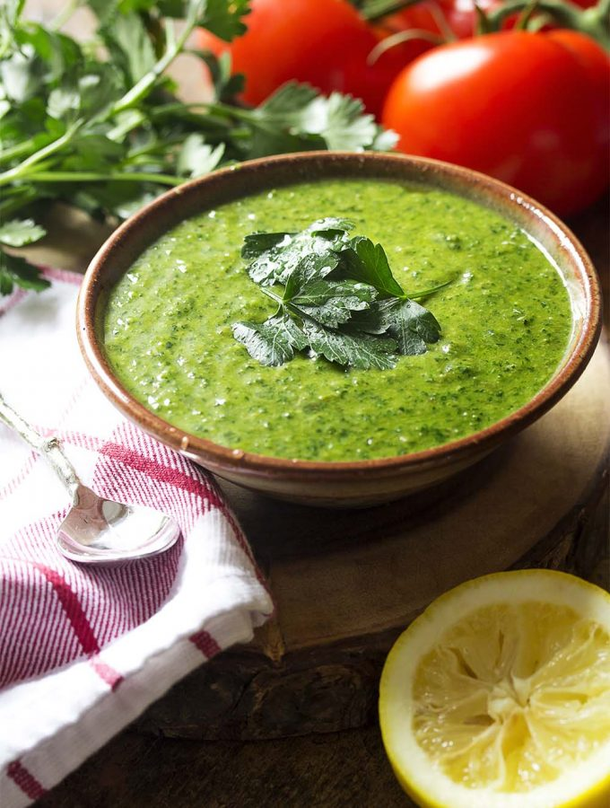 Italian salsa verde is a fresh and easy homemade green sauce made from parlsey and basil. It's great on everything from pasta to seafood and chicken to steak! | justalittlebitofbacon.com #italianrecipes #saucerecipes #sauces #parsley #anchovies