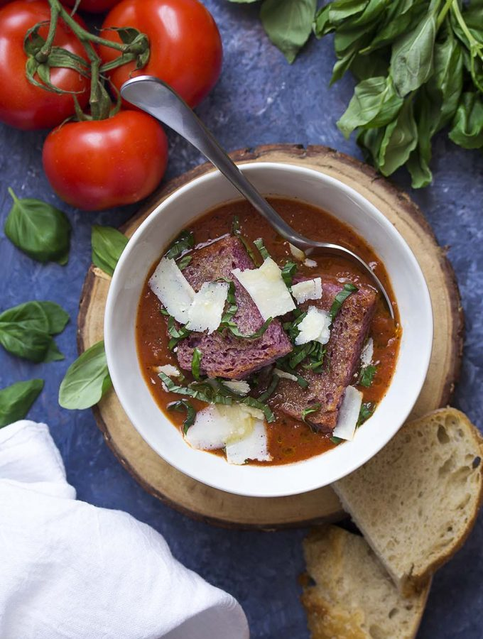 Canned fire roasted tomatoes are the secret to an easy and delicious tomato basil soup! No cream needed for a rich flavor and a great soup.