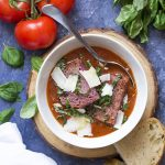 Canned fire roasted tomatoes are the secret to an easy and delicious tomato basil soup! This homemade soup needs no cream for a rich flavor and it's a great part of a healthy diet.   justalittlebitofbacon.com #italianrecipes #souprecipes #soup #tomatosoup #tomatoes