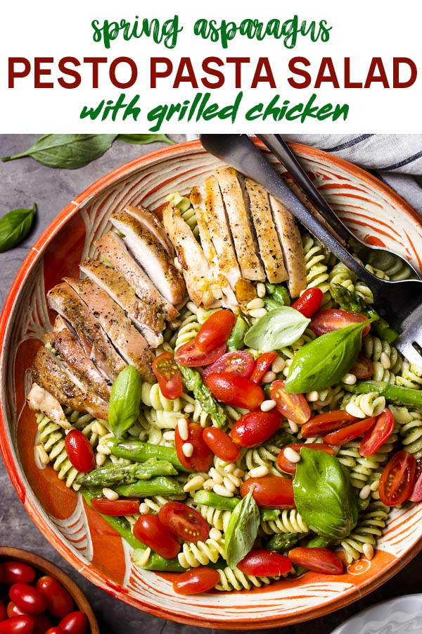 Chicken pasta salad in a serving bowl with text overlay - Pesto Pasta Salad
