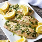 Turn on your oven to make the best tender slow roasted salmon! Served with a lemon herb sauce, it's simple to make and a great part of a healthy diet. | justalittlebitofbacon.com #mediterraneanrecipes #salmon #salmonrecipes #fishrecipes #easydinners
