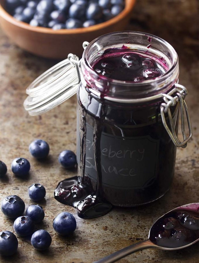 It's easy to make fresh and homemade blueberry sauce! A few minutes of cooking and you'll be spooning this fruit compote over pound cake, cheesecake, pancakes, ice cream, and more. | justalittlebitofbacon.com #blueberries #fruitsauce #berries #cheesecake #pancakes
