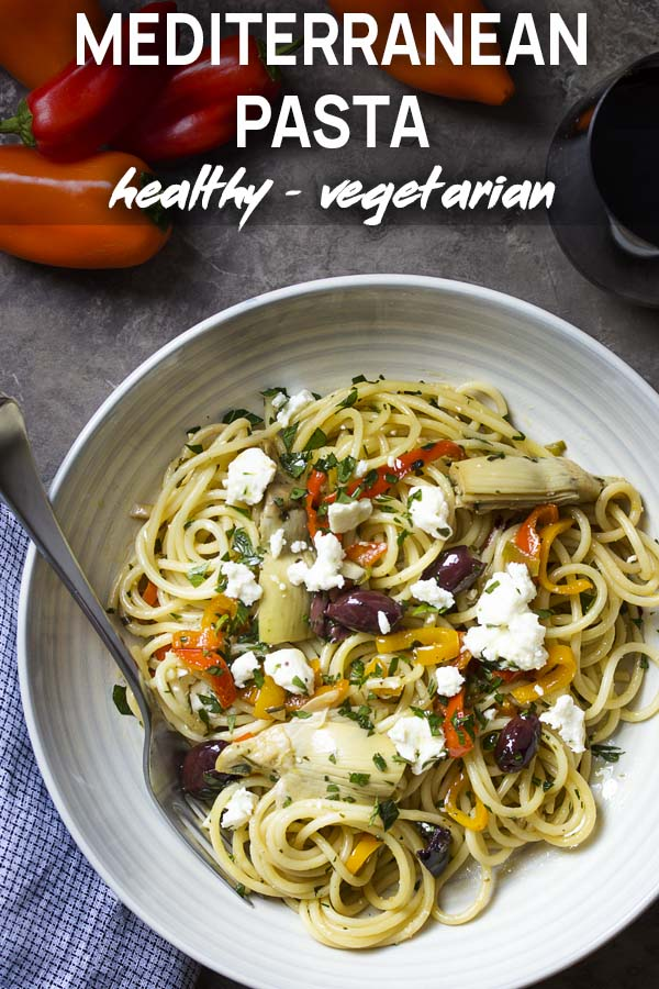 A bowl of spaghetti, vegetables, and cheese with text overlay - Mediterranean Pasta.