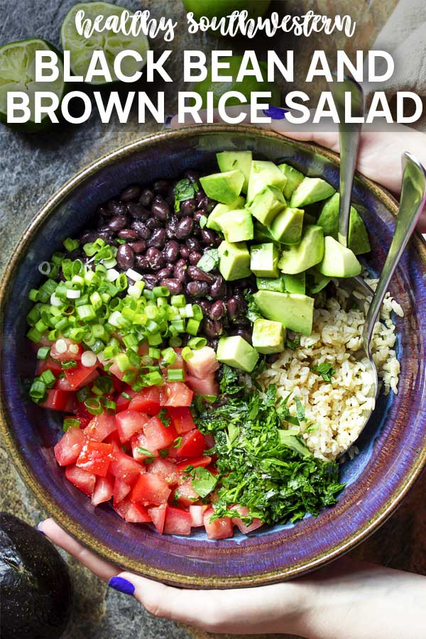 Squeezing a lime into a bowl of salad with text overlay - Brown Rice and Black Bean Salad.