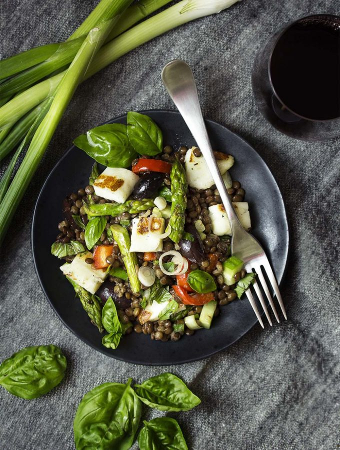 You'll love this healthy and easy halloumi lentil salad! Grilled halloumi, French lentils, grilled vegetables are tossed in a simple vinaigrette for Mediterranean summer lunch or dinner. Vegetarian, gluten-free, and best served warm. | justalittlebitofbacon.com #mediterraneanrecipes #summerrecipes #saladrecipes #halloumi #salad #vegetarian
