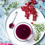 A great way to enjoy in season fresh red currants is to make a sweet and tangy red currant sauce perfect for pork, venison, duck, salmon, chicken, and more! | justalittlebitofbacon.com #sauces #redcurrants #savorysauce
