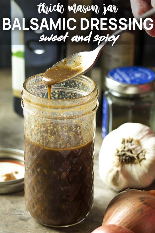 A mason jar of dressing being spooned out with text overlay - Balsamic Dressing.