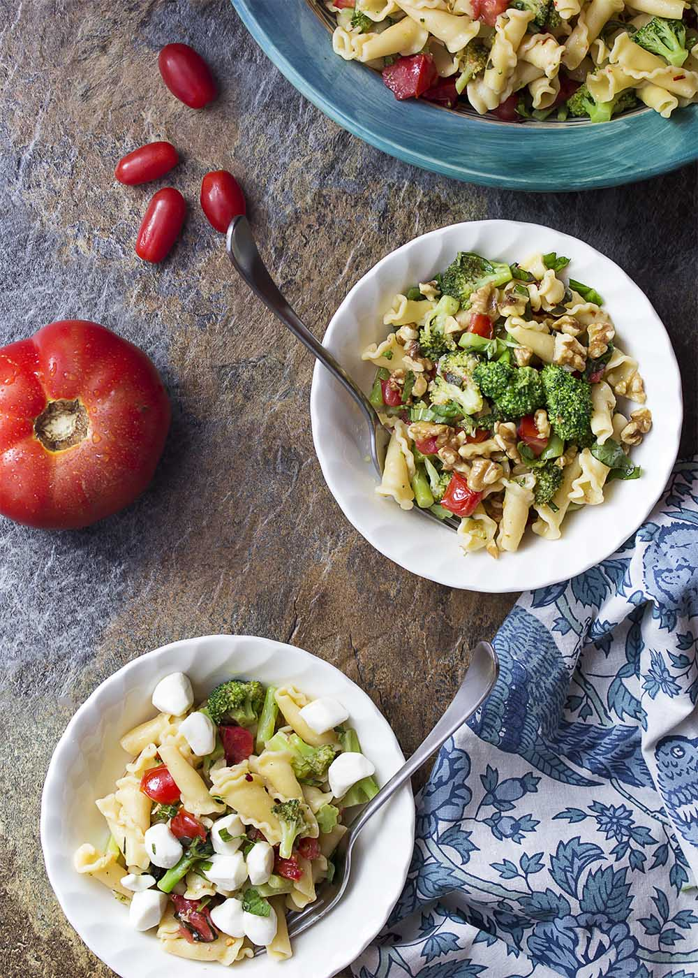 Two bowls of summer pasta each with optional add ins.