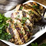 Grilled balsamic chicken is a simple and flavorful Italian-themed meal! Chicken breast or thighs are quickly marinated in a balsamic vinaigrette and then given a turn on the grill for juicy, tender meat. | justalittlebitofbacon.com #grilledchicken #chickenrecipes #chickenbreast #chickenthighs #grillingrecipes #italianrecipes