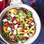 Grilled peach salad is fresh summer side full of sweet and smoky peaches, toasted pecans, berries, and goat cheese all tossed with a maple vinaigrette! | justalittlebitofbacon.com #summerrecipes #saladrecipes #peaches #salads #sidedishrecipes