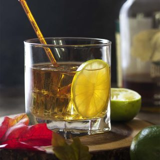 Fall, winter, spring, or summer, you'll love sipping a simple maple lime bourbon sour! This drink is the perfect balance of sweet and sour combined with smooth whiskey to make a refreshing cocktail. | justalittlebitofbacon.com #cocktailrecipes #drinkrecipes #drinks #bourbon #cockails