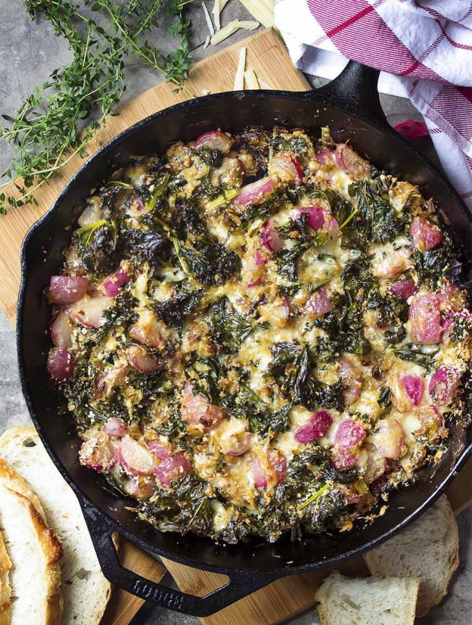 To make the best leek gratin I add sauteed radishes and chopped up young kale leaves along with just enough cream and gruyere cheese to make a melty, creamy, roasty side dish right in my cast iron pan. | justalittlebitofbacon.com #sidedishrecipe #gratin #leeks #kale #radishes #frenchrecipes