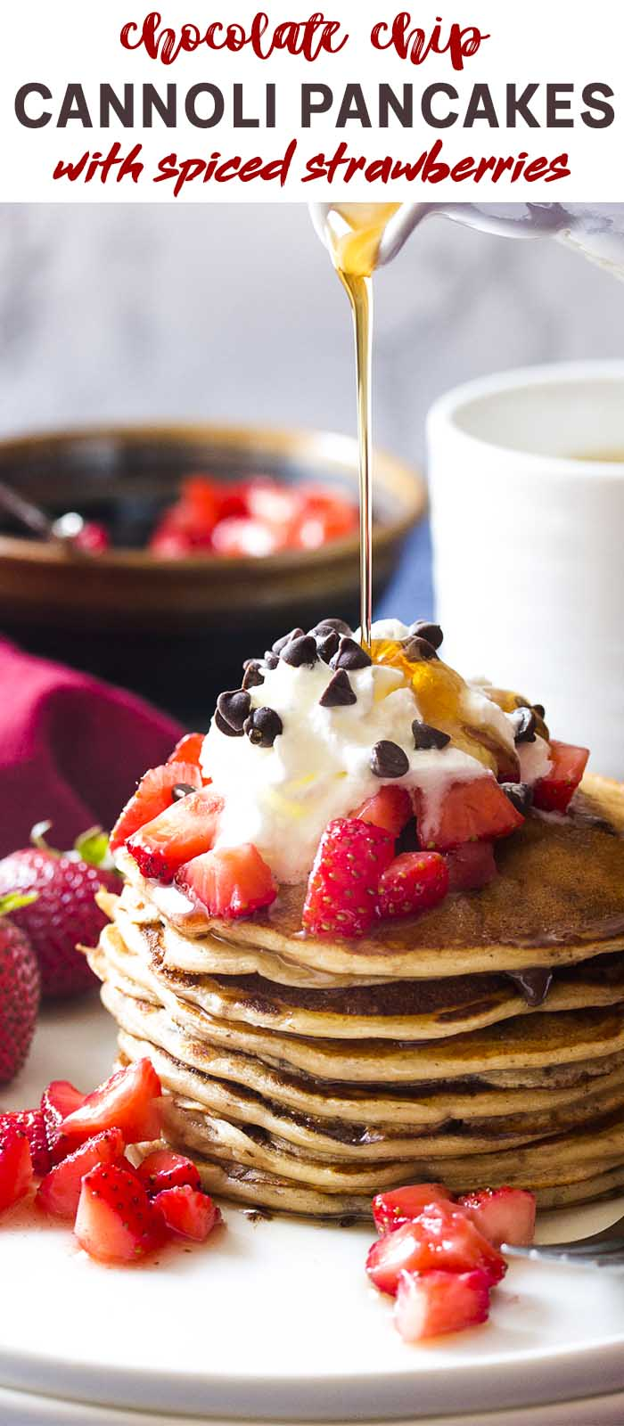 Syrup pouring onto a stack of pancakes and strawberries with text overlay - Cannoli Pancakes.