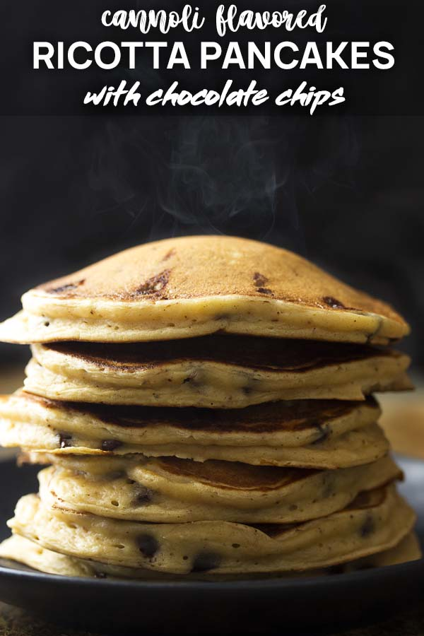 Steaming stack of chocolate chip pancakes on a black plate with text overlay - Ricotta Pancakes.