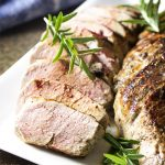 For the best roast pork tenderloin, give the meat a herb rub with rosemary and mustard, sear it in a cast iron skillet, and then finish the roast in the oven until perfectly cooked. Simple, delicious, and juicy! Perfect for a quick weeknight dinner. | justalittlebitofbacon.com #porkrecipes #dinnerrecipes #porktenderloin #porkroast #easyrecipe
