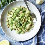 You'll love this simple and fast vegetarian dinner! Pesto is tossed with pasta and white beans and a little pasta water for a creamy sauce and a satisfying meal. Use store-bought pesto for a super quick meal or make your own pesto. | justalittlebitofbacon.com #italianrecipes #vegetarian #vegetariandinners #pasta #pastarecipes
