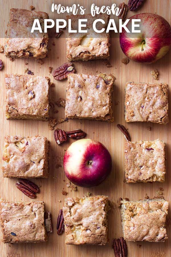Several pieces of cake in rows on a board with text overlay - Apple Cake.