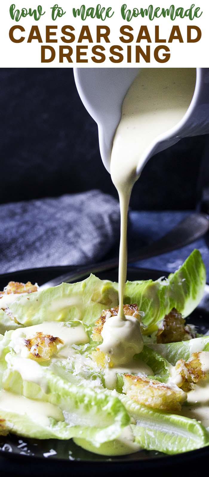 Dressing pouring down onto a plate of salad with text overlay - Caesar Salad Dressing.