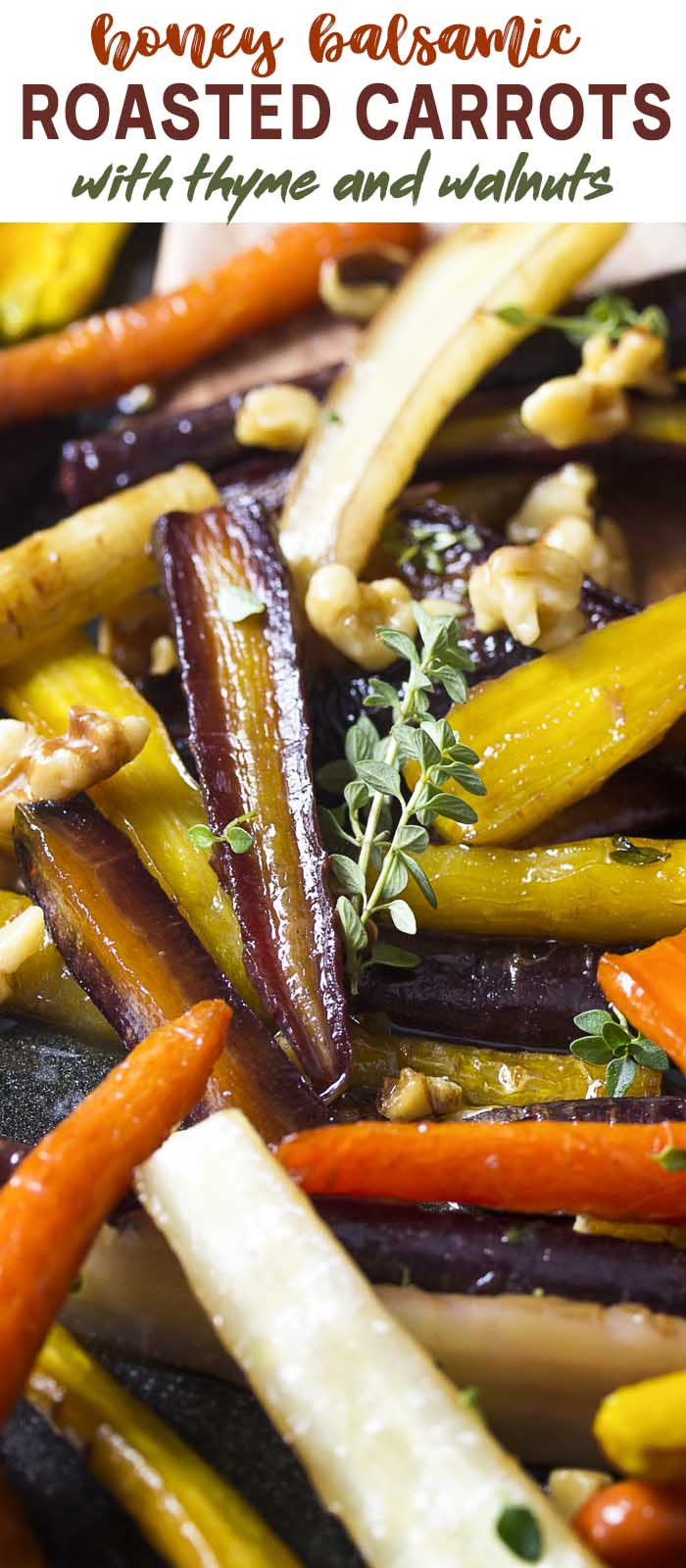 Close up of carrots and thyme in the roasting pan with text overlay - Roasted Carrots.