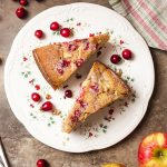 My cranberry apple cake is a simple and moist dessert made with fresh cranberries, diced apples, and ground pecans! This recipe is a great snack cake and is perfect for the holiday table at Christmas and Thanksgiving. | justalittlebitofbacon.com #cakerecipes #applerecipes #christmas #thanksgiving #holidayrecipes #apples #cranberries
