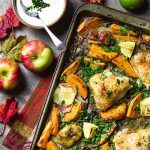 Easy, one pan, quick clean up! My recipe for sheet pan chicken thigh dinner with sweet potatoes, apples, and onions is a healthy oven baked meal packed full of flavor and veggies.   justalittlebitofbacon.com #chickenrecipes #easydinners #sheetpandinner #chickenthighs #sweetpotatoes