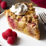 My homemade apple raspberry pie is the best! It's packed full of sliced apples and fresh, sweet raspberries then covered with a buttery streusel crumb topping. Perfect for holidays, Christmas, and Thanksgiving. | justalittlebitofbacon.com #christmasrecipes #thanksgivingrecipes #holidayrecipes #dessertrecipes #applepie #raspberrypie #pie